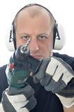 Handyman med drillborren arkivbilder