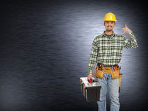 Handyman and metal background Royalty Free Stock Photography
