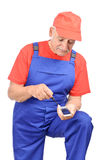 Handyman mobile phone repair Royalty Free Stock Image