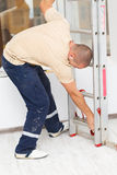 Handyman Mounting Step Ladder Royalty Free Stock Image