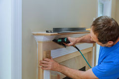 Handyman nailed up Moulding Accents in the new house Royalty Free Stock Image
