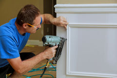 Handyman nailed up Picture Moulding wall in the new house Royalty Free Stock Images