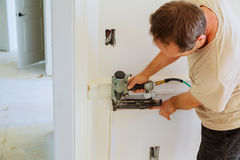Handyman nailed up Picture Moulding wall in the new house Royalty Free Stock Image