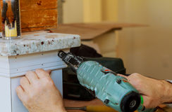 Handyman nailed up Picture Moulding wall in the new house Royalty Free Stock Photos