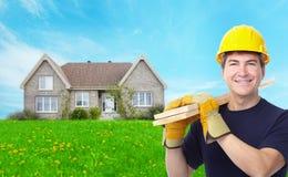 Handyman near new house. Renovation concept background stock photography