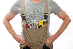 Handyman in overalls Royalty Free Stock Images