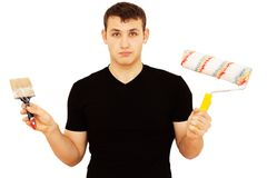Handyman with a paint brush and roller Royalty Free Stock Images