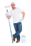 Handyman with paint can and roller Royalty Free Stock Images