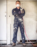 Handyman with paint sprayer Stock Photo
