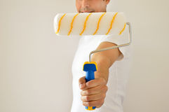 Handyman with painter roller Stock Photography