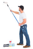 Handyman painting with roller Royalty Free Stock Photo