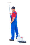 Handyman painting with roller on white background Stock Photos