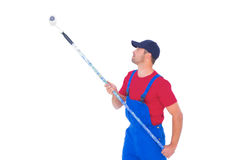 Handyman painting with roller on white background Royalty Free Stock Image
