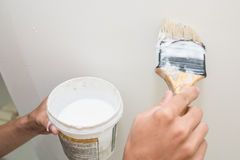 Handyman painting on the wall Stock Photography