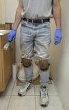 Handyman plumber installing new toilet Royalty Free Stock Images