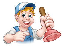 Handyman Plumber With Plunger Cartoon Character. A plumber handyman cartoon character holding a plunger and pointing Royalty Free Stock Photography