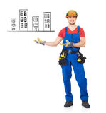 Handyman points on the house Royalty Free Stock Photo