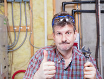 Handyman. Portrait of a happy handyman showing thumbs up royalty free stock photography