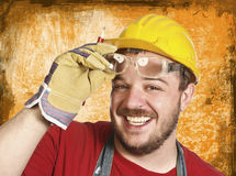 Handyman with protection glass Royalty Free Stock Image