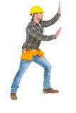 Handyman pushing something Stock Images