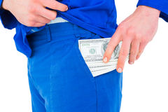 Handyman putting money in his pocket Royalty Free Stock Photography