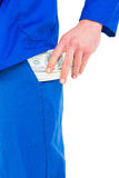 Handyman putting money in his pocket Royalty Free Stock Images