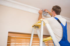 Handyman putting scotch on the ceiling Royalty Free Stock Photos