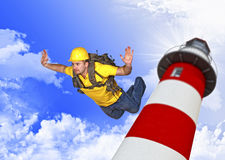 Handyman quick reaction force. Jump from lighthouse Royalty Free Stock Photography