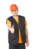 Handyman in red protective helmet. Stock Photo