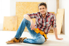 Handyman relaxing. Royalty Free Stock Photography