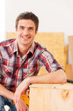 Handyman relaxing after work. Royalty Free Stock Image