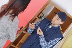 Handyman repair door lock in room. Handyman repair the door lock in the room Royalty Free Stock Images