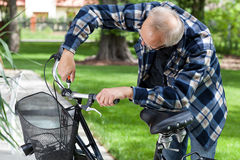 Handyman repairing bicycle handlebar stock photo
