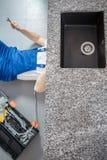 Handyman repairing black sink drain royalty free stock photos