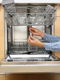 Handyman repairing a dishwasher Royalty Free Stock Images