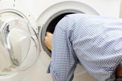 Handyman repairing a washing machine Royalty Free Stock Photography