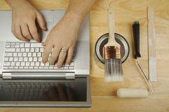 Handyman Researches on Laptop Royalty Free Stock Photo