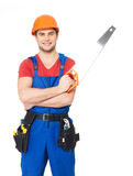 Handyman with saw. Smiling handyman with saw full portrait over white background royalty free stock photos