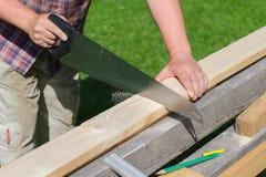 Handyman sawing Royalty Free Stock Photos