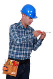 A handyman with a screwdriver. Royalty Free Stock Image