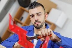 Handyman searching in tool box for necessary tools Stock Photos
