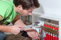 Handyman searching a solution Royalty Free Stock Photo
