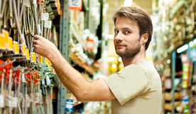 Handyman shopping in DIY outlet Royalty Free Stock Photography