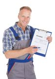 Handyman showing invoice on clipboard Stock Photos