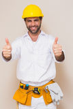 Handyman showing thumbs up to camera Stock Images