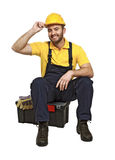 Handyman sit on his toolbox Stock Photo