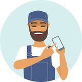 Handyman with smartphone Royalty Free Stock Images