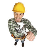 Handyman smile and hold wrench Royalty Free Stock Photography