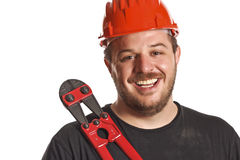 Handyman smile and tool Royalty Free Stock Image