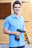 Handyman Standing Outside Garden Shed With Tools Royalty Free Stock Image